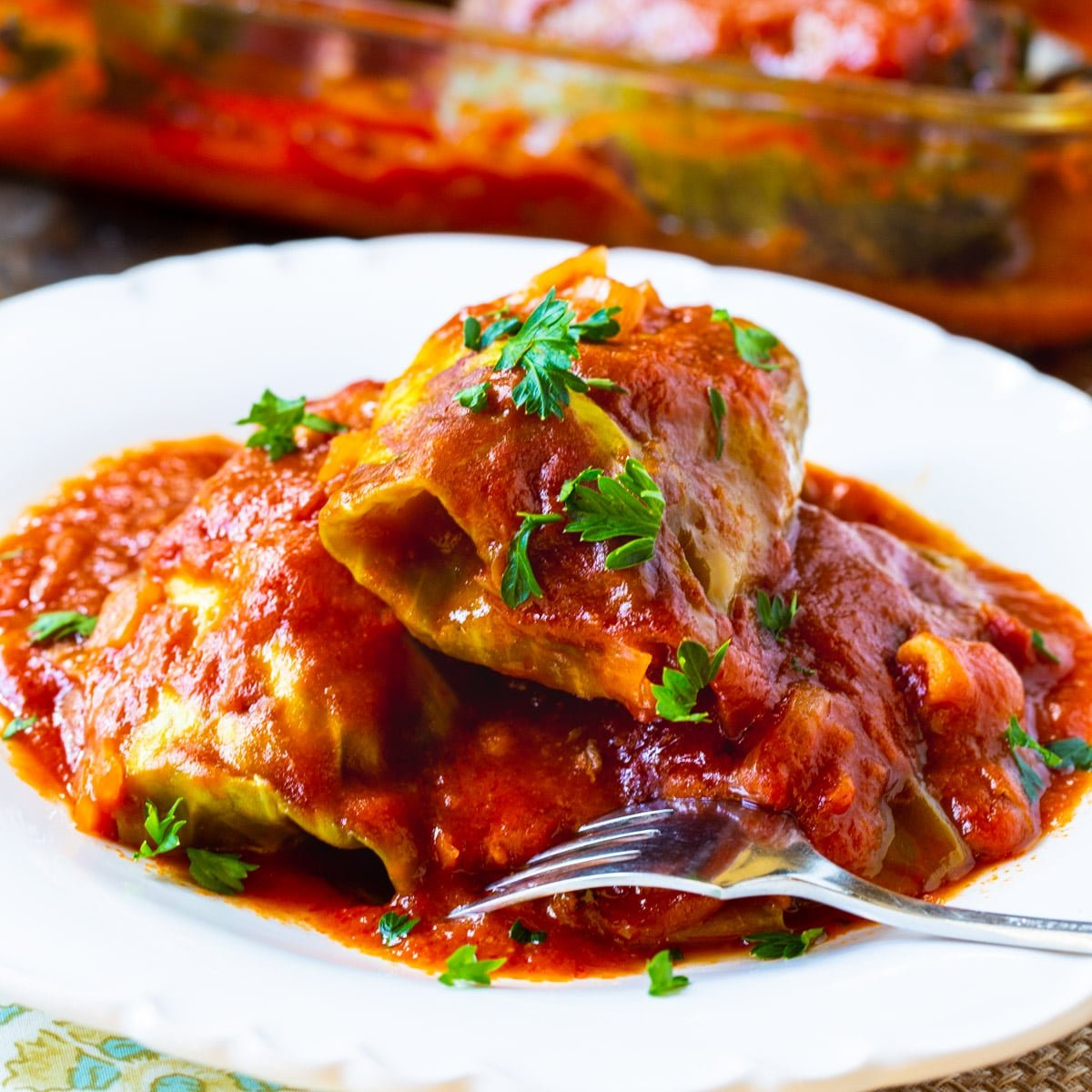 Three Stuffed Cabbage Rolls on a plate.