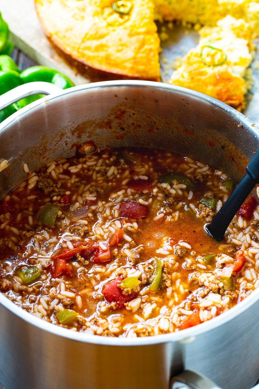 Pot full of Stuffed Pepper Soup with cornbread.
