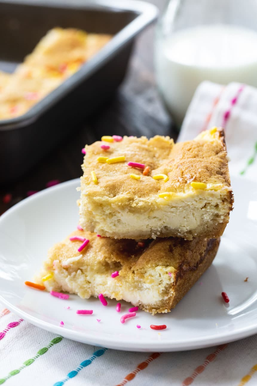 Two Sugar Cookie Cheesecake Bars on a plate.
