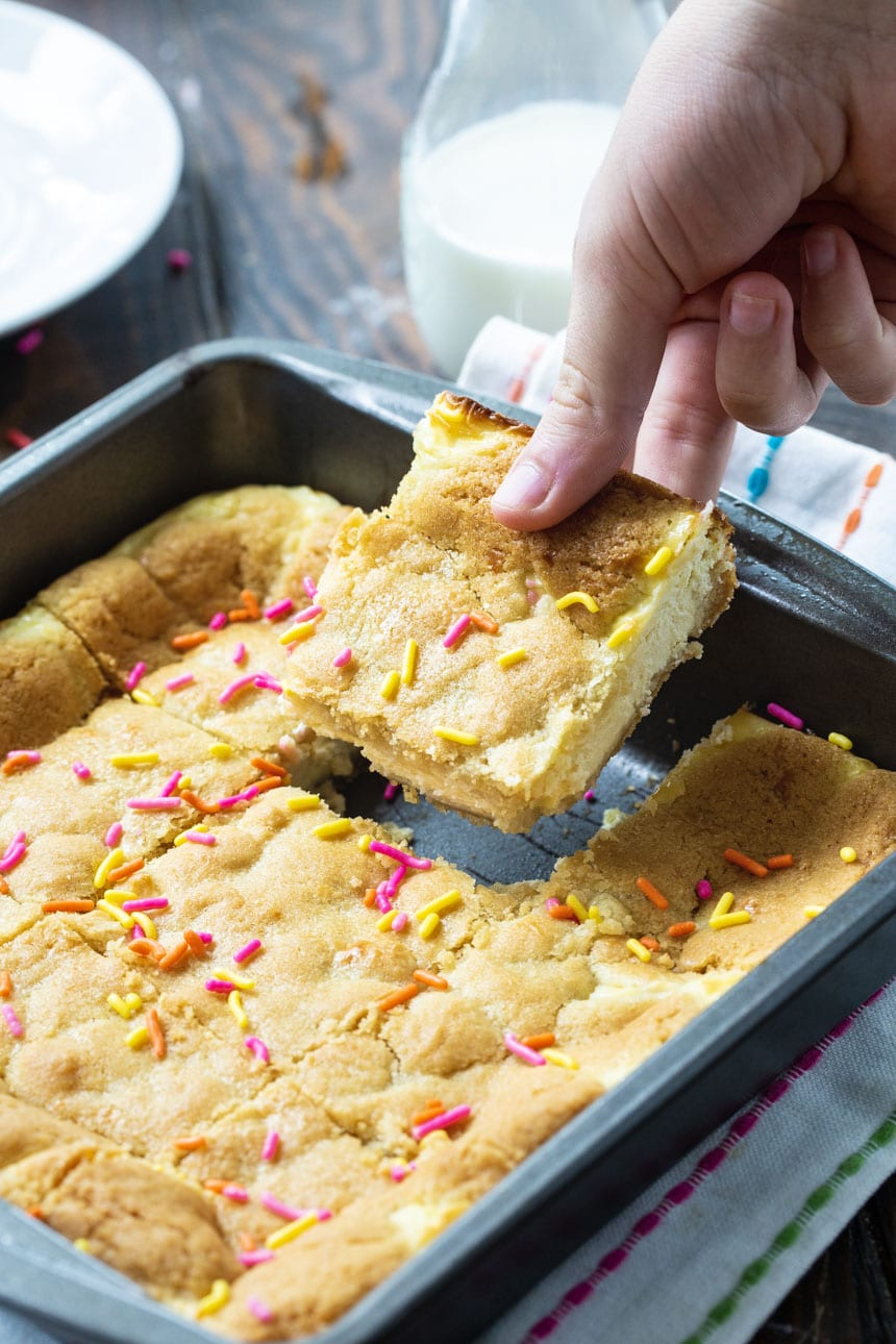 Cheesecake Bars made from Sugar Cookie dough in an 8-inch baking dish