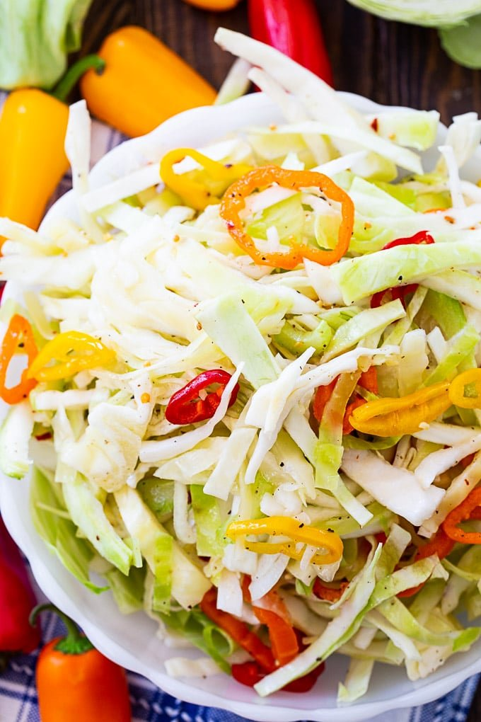 Marinated Cabbage Slaw with red, orange, and yellow sweet peppers.