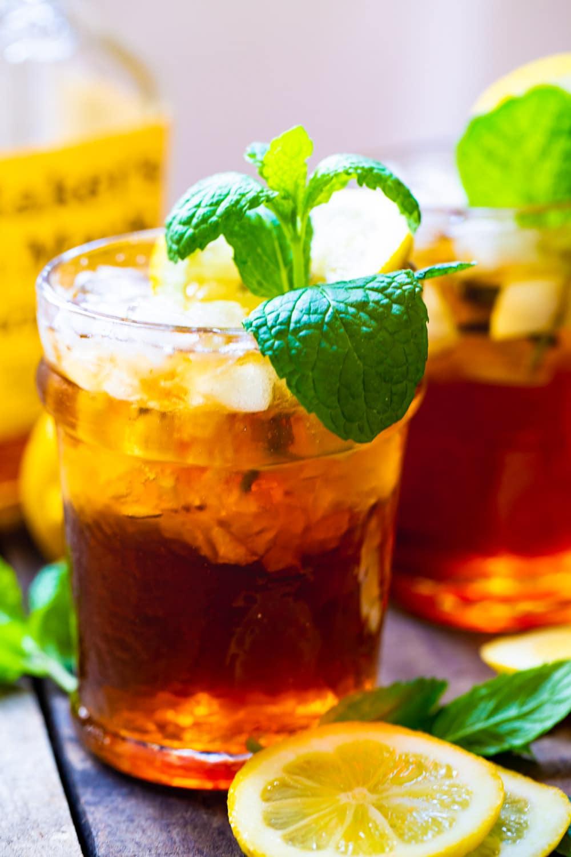 Sweet Tea Mint Juleps with bottle of bourbon.