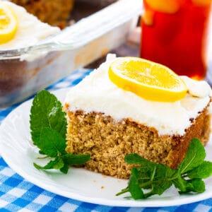 Slice of Sweet Tea and Lemonade Cake on a plate with fresh mint.