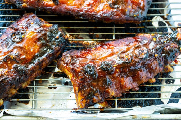 Babay Back Ribs on a wire rack.