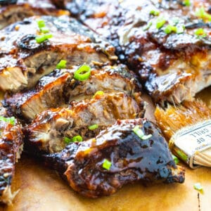 Ribs on a wooden cutting board.