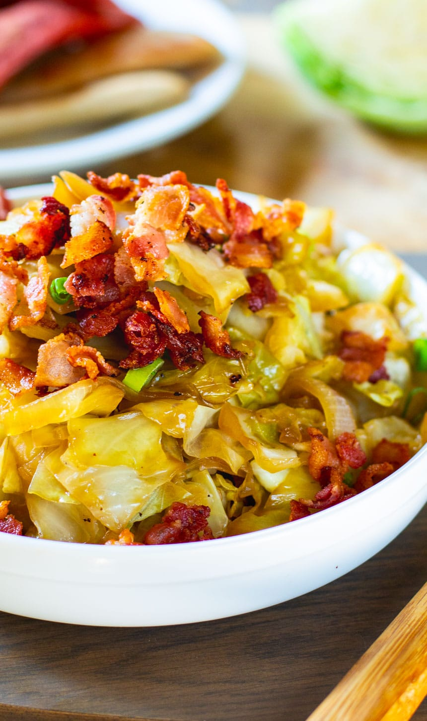 Sweet and Sour Cabbage with Bacon in a white bowl.