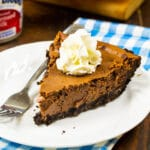 Slice of Sweetened Condensed Milk Chocolate Pie on a plate.