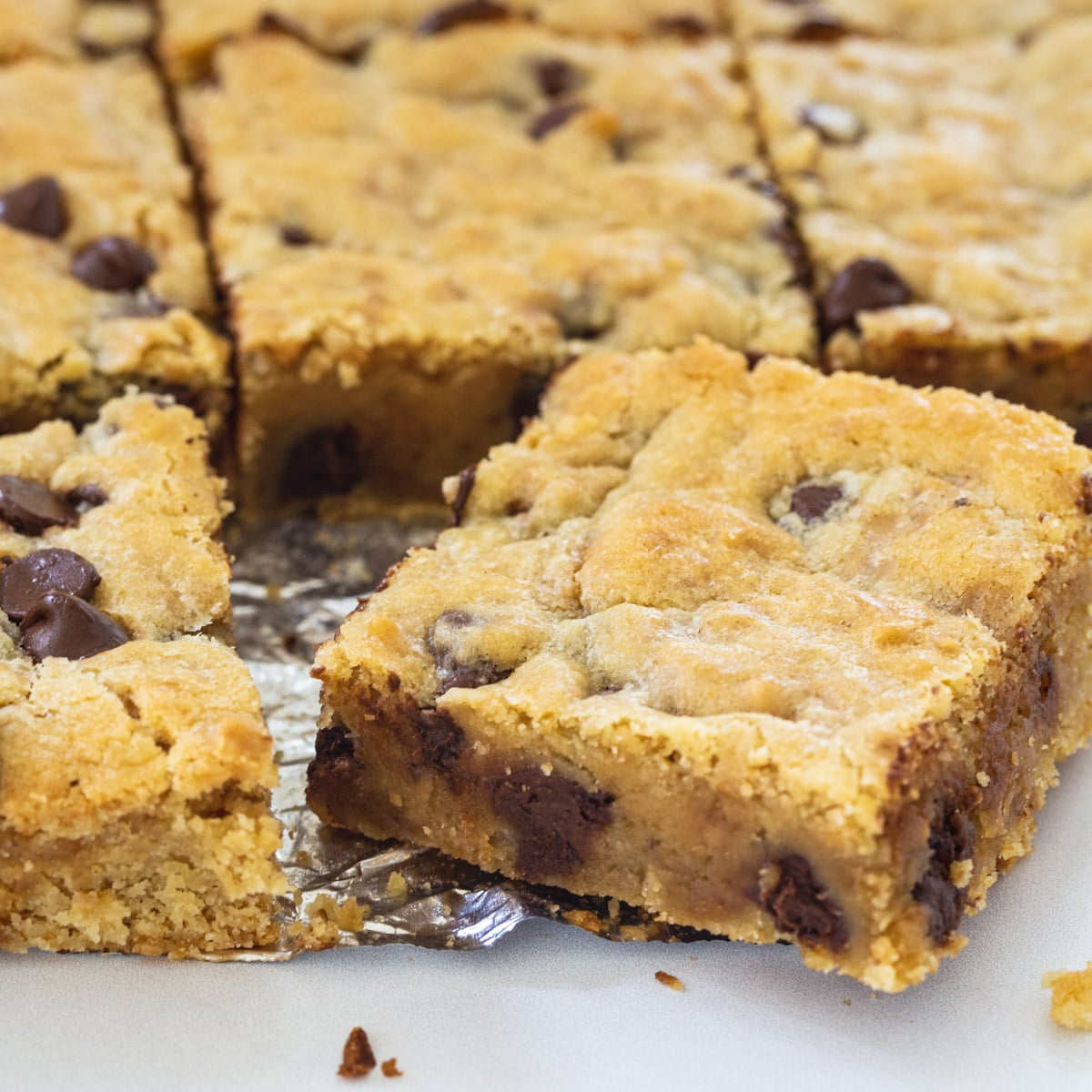 Toffee Chocolate Chip bars cut into squares.
