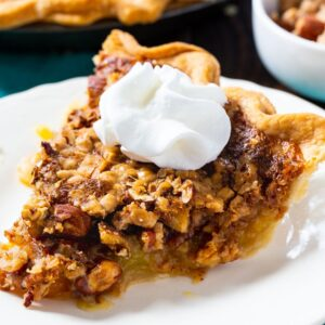 Toffee Nut Pie slice topped with whipped cream.