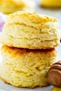 Two Tupelo Honey Biscuits stacked on a plate.