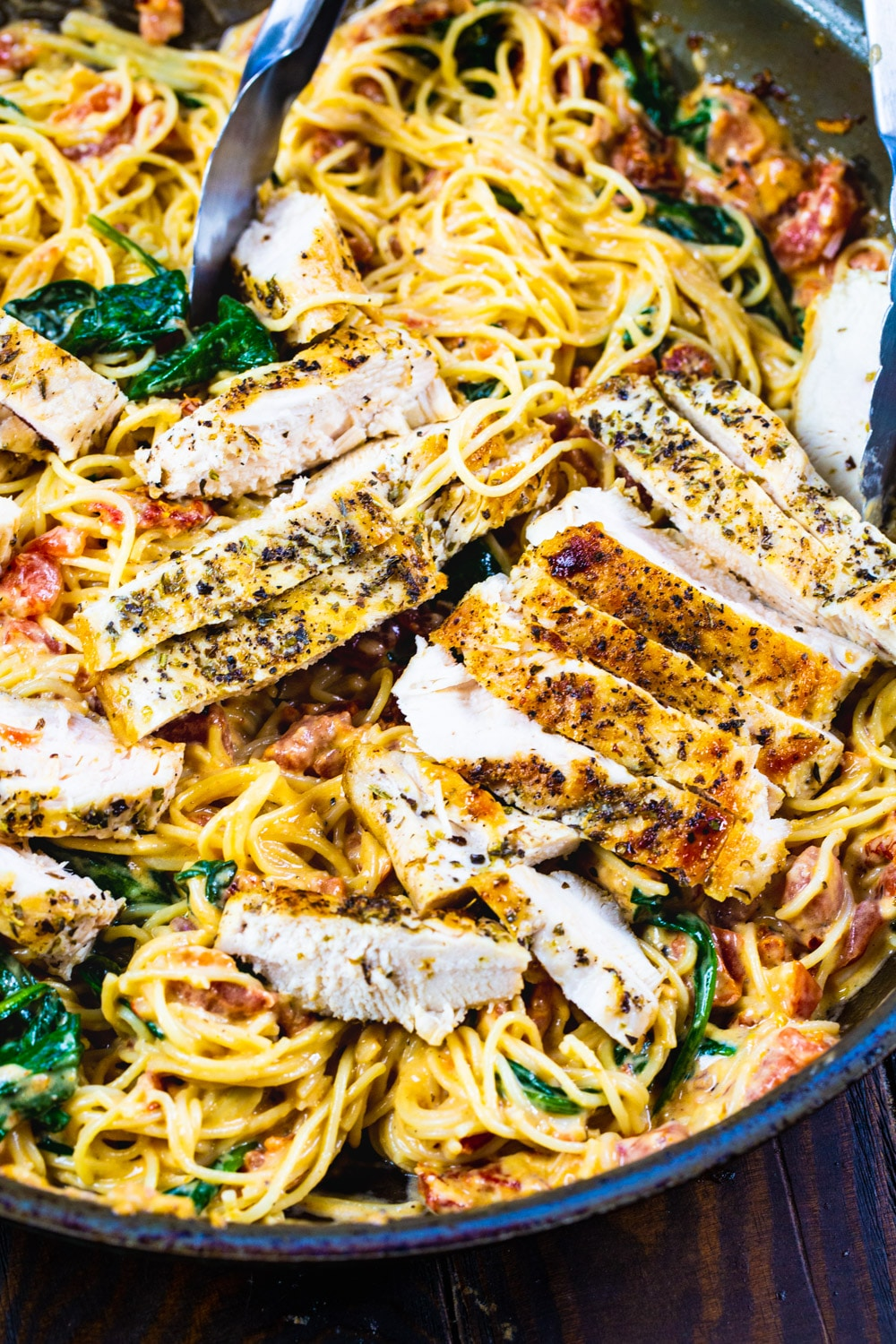 Tuscan-Style Pasta with chicken in a large skillet.