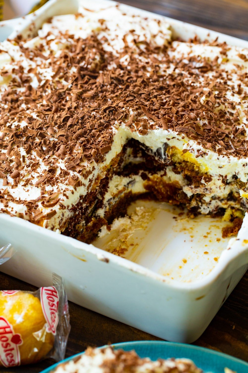Tiramisu in serving dish with piece cut out.