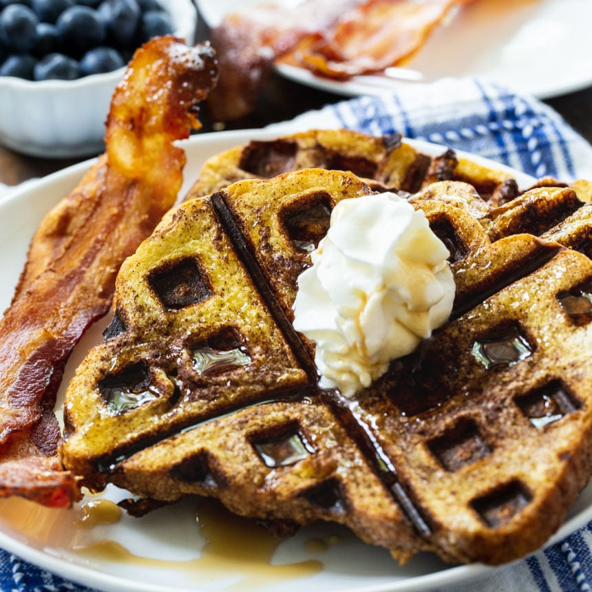 Waffled French Toast on a plate with bacon