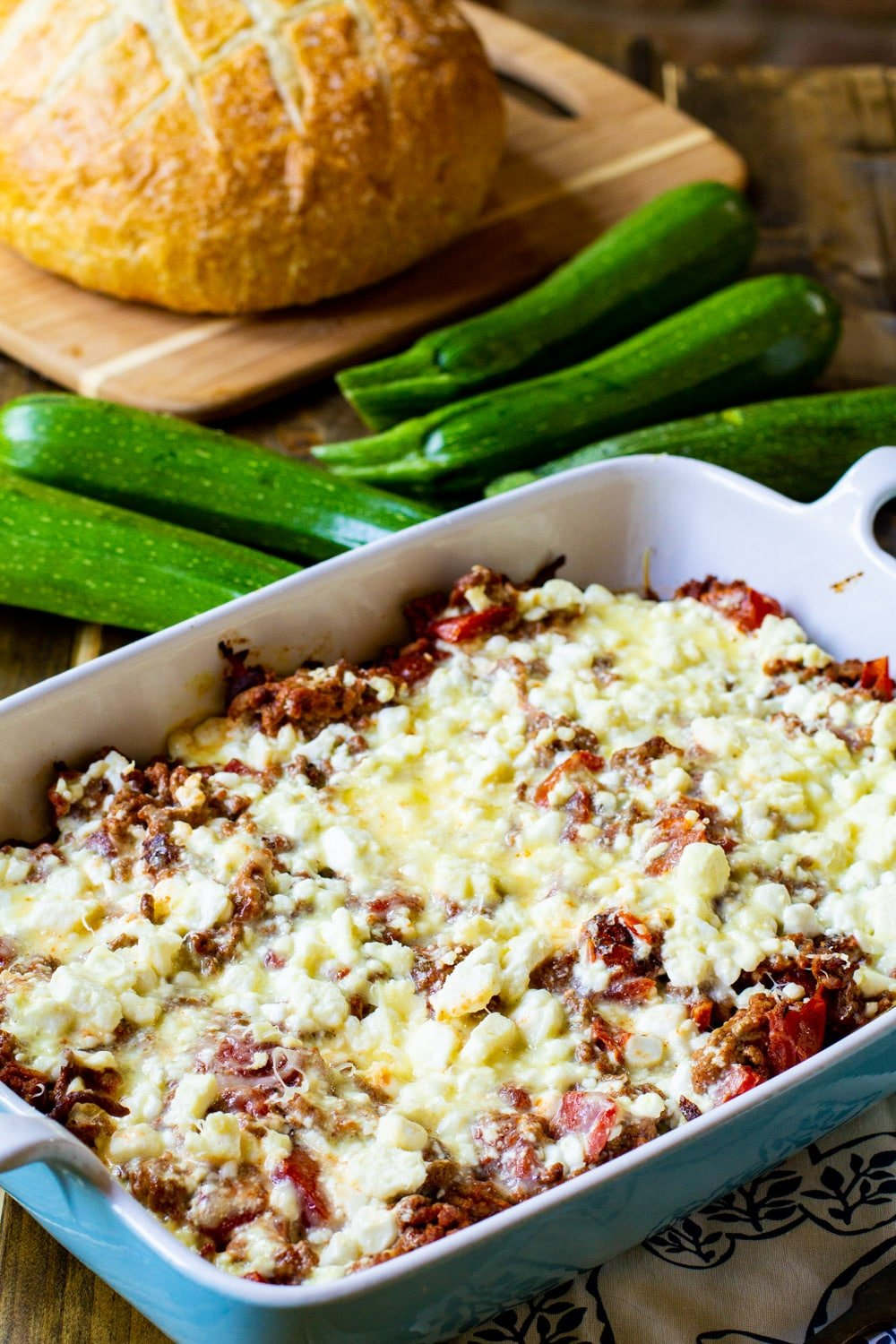 Zucchini Moussaka with a loaf of bread.