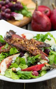 Apple and Pear Salad with Maple Pecan Bacon and Cranberry Vinaigrette. Such a delicious fall salad!