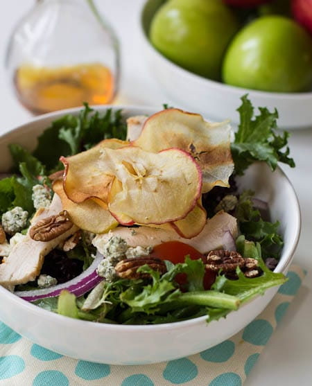 Fuji Apple Chicken Salad with bowl of apples in background.