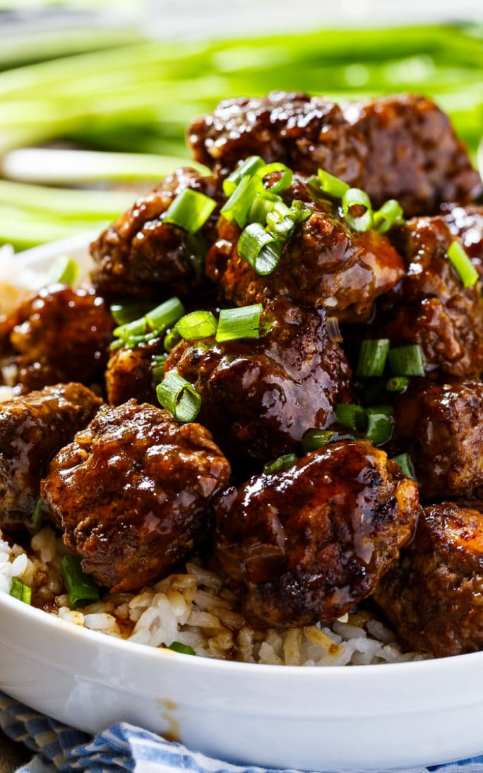 Spicy Apple-Glazed Meatballs piled up high in a bowl.