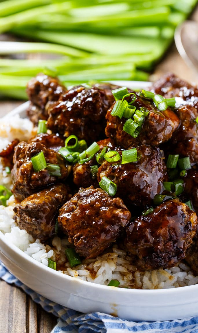 Spicy Apple-Glazed Meatballs served over rice in a bowl.