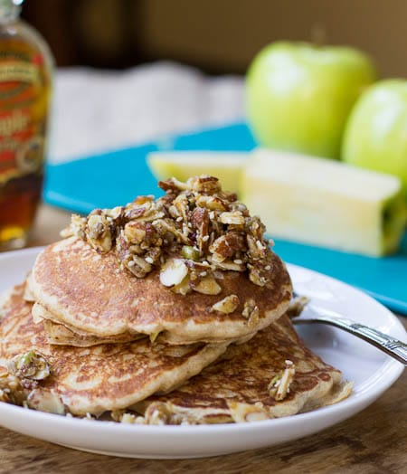 Whole Wheat Pancakes with Nutty Topping on a white plate.
