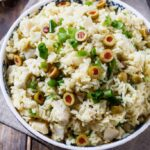 Artichoke-Rice Salad- a cool and creamy side dish flavored with curry powder. Perfect for summer potlucks and picnics.
