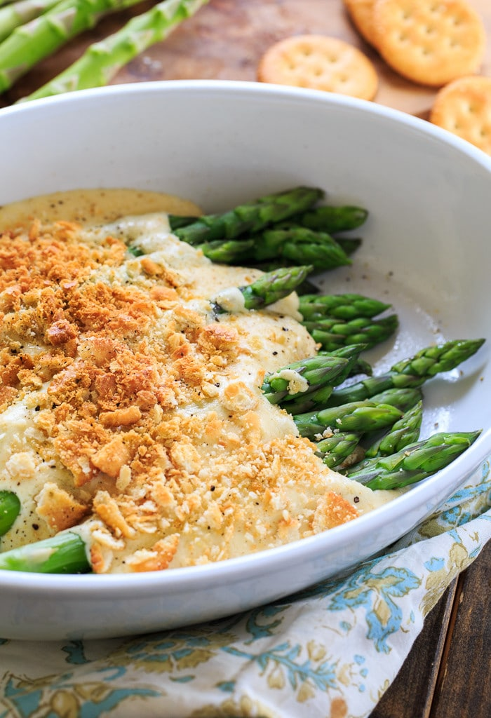 Asparagus Mornay- tender asparagus stalks covered in a cheesy sauce and crushed Ritz crackers. Perfect for Easter brunch.