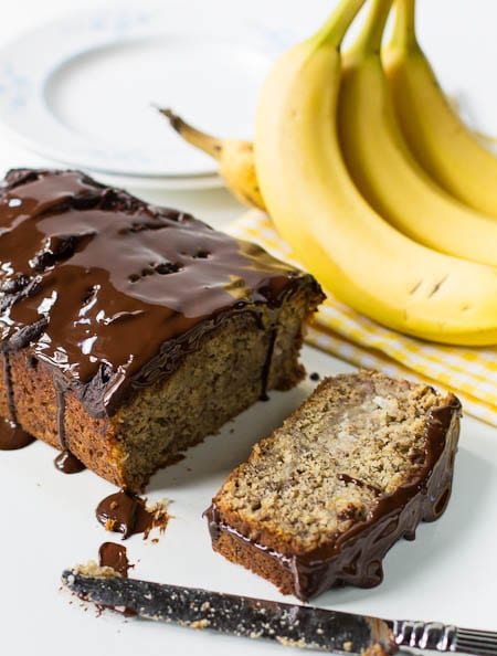 Banana Bread with one slice cut.