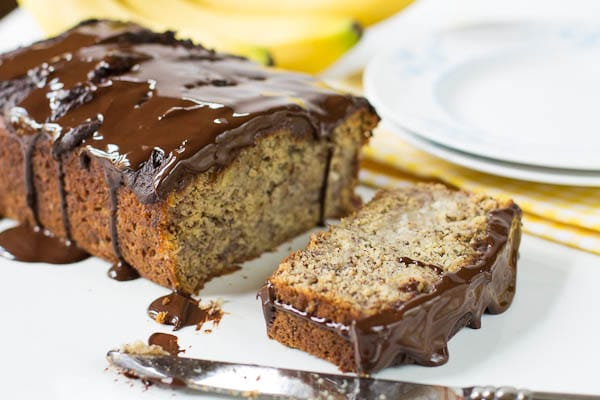 Banana Bread with Chocolate Glaze with one slice cut.