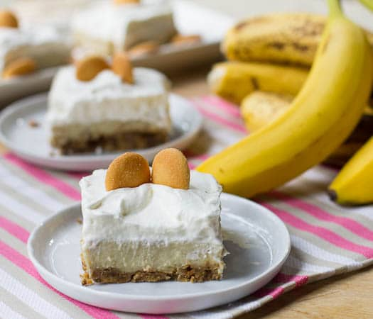 Banana Pudding Bars cut into squares and topped with vanilla wafers.
