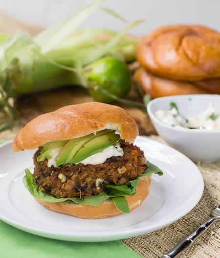 Grateful Dead Black Bean Burger with avocado on a white plate.