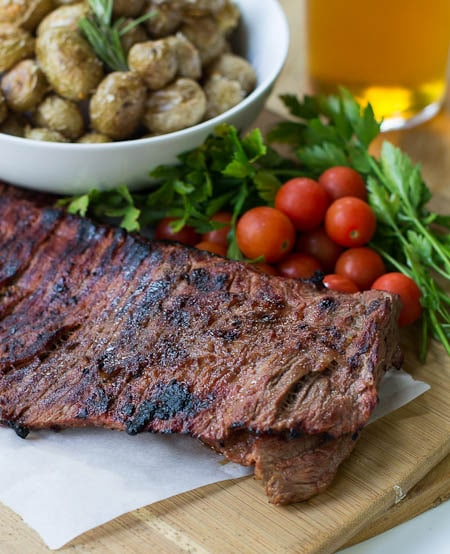 Grilled Skirt Steak with cherry tomatoes and parsley.