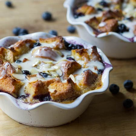 Blueberry White Chocolate Bread Pudding with Amaretto Cream in 2 small baking dishes.
