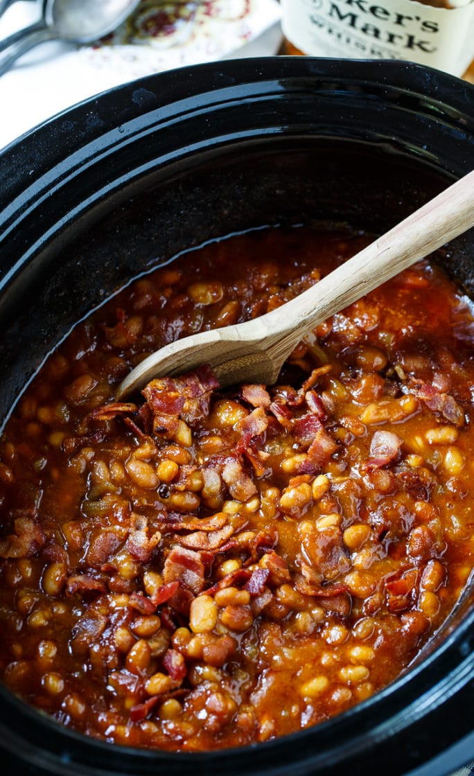 Slow Cooker Bourbon Baked Beans in a black slow cooker.