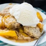 Skillet Bourbon Peach Cobbler with Cinnamon Sugar Dumplings