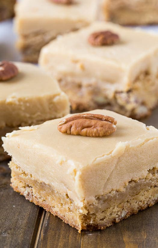 Butterscotch Blondies with pecans and a thick layer of icing.
