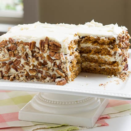 Carrot Cake with chopped pecans on the sides.