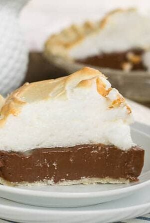 Old-Fashioned Chocolate Meringue Pie slice on a white plate.