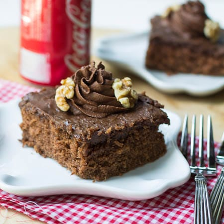 Coca Cola Cake on small plate with Coke can in background.