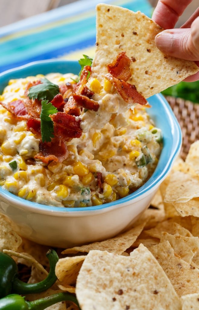 Slow Cooker Corn Dip. Dump all ingredeints in the crock pot and 2 hours later you have a warm and creamy dip.
