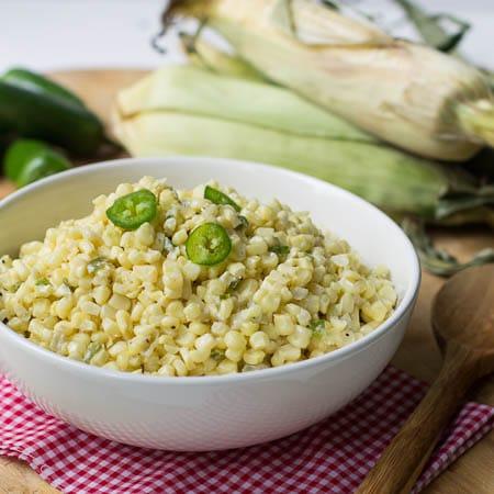 Jalapeno Creamed Corn in white serving bowl.
