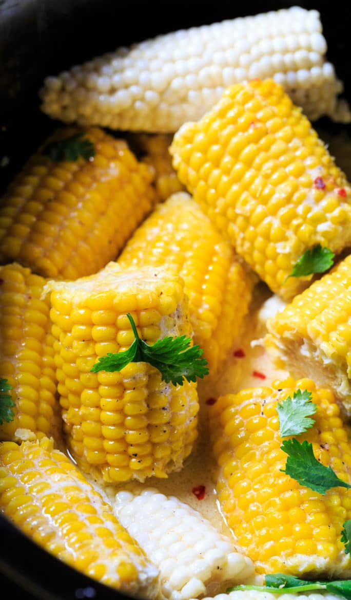 Crock Pot Corn on the Cob cooked with coconut milk and butter.