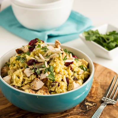 Curried Rice Salad with in a blue bowl.