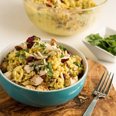 Curried Rice Salad in a blue bowl.
