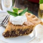 Kentucky Derby Pie has a gooey chocolate and walnut filling with a splash of bourbon. Top with bourbon whipped cream!