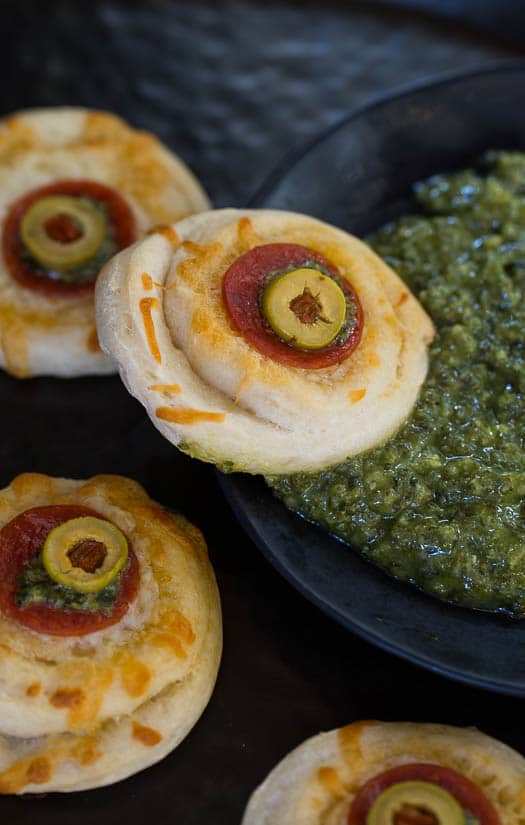Monster Eyeball Pizzas a spooky treat for Halloween.