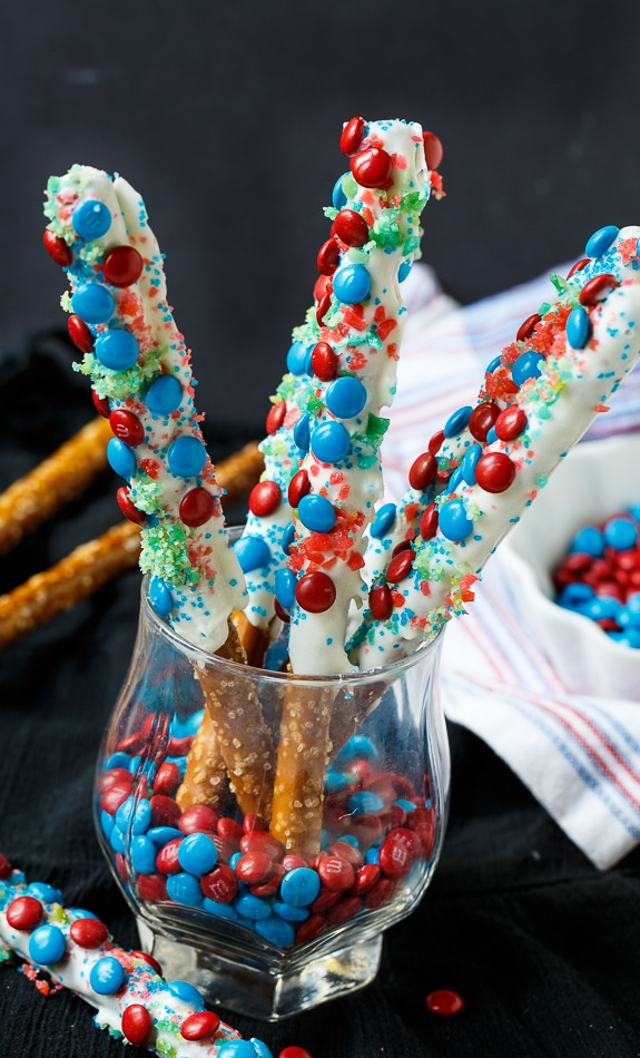 Firecracker Pretzel Rods for the 4th of July. Covered in red and blue mini M&Ms and Pop Rocks candy.
