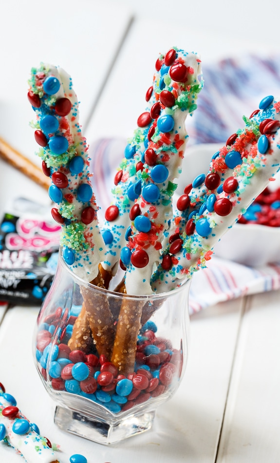 Firecracker Pretzel Rods for the 4th of July. Covered in red and blue mini M&M's and Pop Rocks.