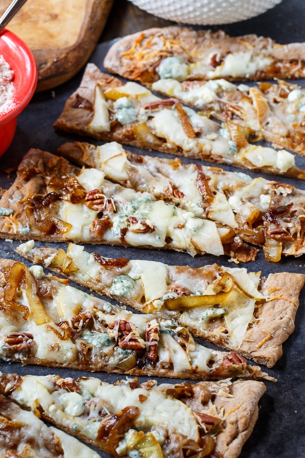 Cheesy Caramelized Onion Flatbread with pears, blue cheese, and pecans.