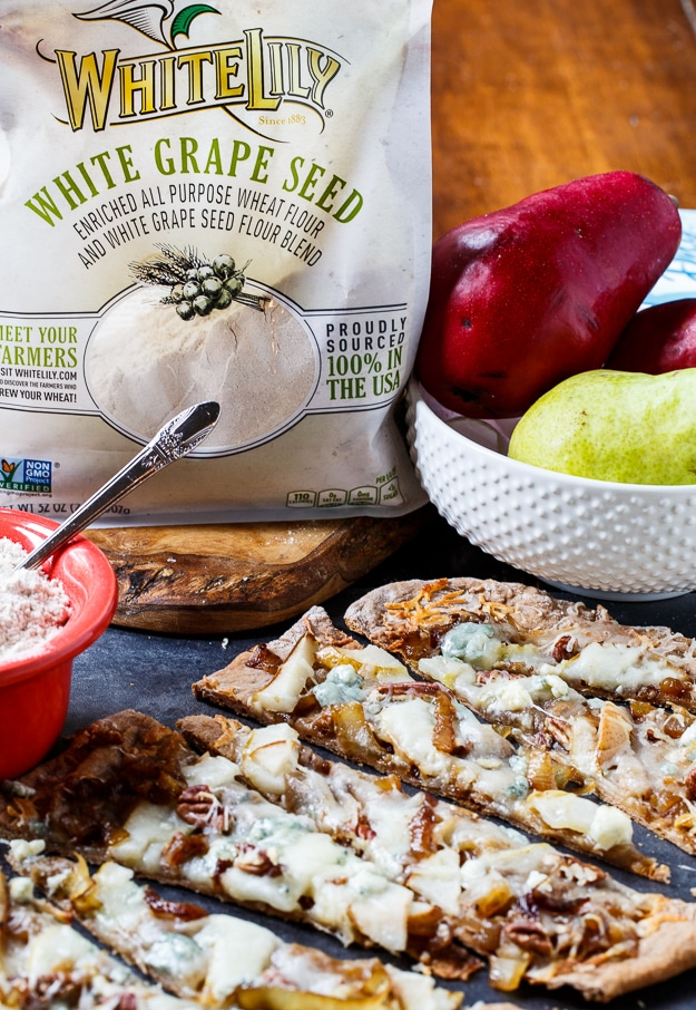 Cheesy Caramelized Flatbread with pears, blue cheese, and pecans. Made with White Lily Premium White Grape Seed Blend Flour.