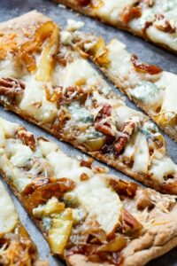 Cheesy Caramelized Onion Flatbreads with pears, blue cheese, and pecans.
