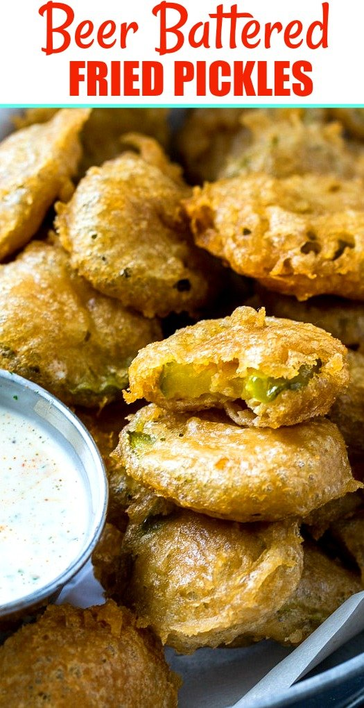 Close-up of fried pickles with dipping sauce.